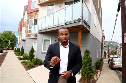 Emeka Owugbenu in front of one of his development properties in Lawrenceville.