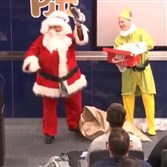 Pat Narduzzi, dressed as Santa Claus, delivers New Era Pinstripe Bowl gifts to Pitt players on Thursday, Dec. 22, 2016.