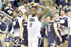 Pitt's Michael Young walks off the court after losing to Notre Dame in overtime Saturday at the Petersen Events Center.