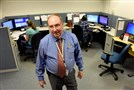 Director Bill Kiger walks through the 24 hour service area of Pennsylvania One Call System Inc., located in West Mifflin. Bill has been with the Call Center for 42 years.
