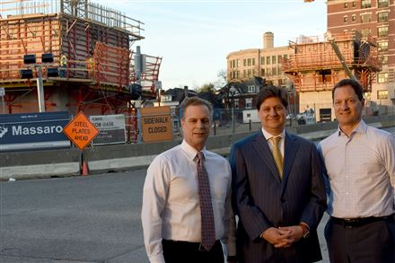 Brothers Steven, David and Joseph Massaro run the Massaro Corp. founded 50 years ago by their father, Joseph Massaro Jr. They're standing in frong of the Empire Apartments construction site at Centre Avenue and North Craig Street intersection in Oakland.