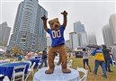 Pitt mascot Roc tries to get the soggy crowd pumped up during fan fest before the team takes on Clemson in the ACC Championship game Saturday, Dec. 1, 2018, at Bank of America Stadium.