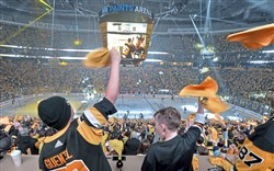 Penguins fans cheer as Sidney Crosby enters the ice to take on the Islanders in game 3 of the Eastern Conference quarterfinals Sunday, April 14, 2019, at PPG Paints Arena.