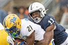 Pitt running back A.J. Davis is brought down by Penn State linebacker Micah Parsons during a 2019 game in University Park, Pa.