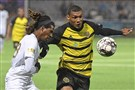 Pittsburgh Riverhounds SC forward Steevan Dos Santos battles for a loose ball with Biriminham Legion FC forward Femi Hollinger-Janzen Saturday, Oct. 26, 2019, at Highmark Stadium on the South Side.