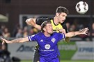 Riverhounds SC defender Joe Greenspan, back, fights for the ball against Louisville City FC midfielder Niall McCabe in the first half Saturday, Nov. 2, 2019, at Highmark Stadium.