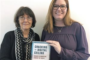 "Carol Frieze, left, and Jeria Quesenberry with their newest book, ""Cracking the Digital Ceiling: Women in Computing Around the World."""