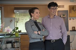Bea Spolidoro and Eric Fisher, both principals of Fisher ARCHitecure, in their kitchen in Shadyside.