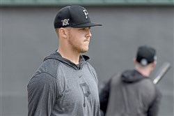 Pirates pitcher Jameson Taillon walks through the warmup field Wednesday on Feb. 26 at LECOM Park in Bradenton, Fla.