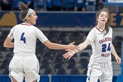 Chartiers Valley's Megan McConnell and Aislin Malcolm high-five after a basket against Trinity during the WPIAL 5A championship on Saturday, Feb. 28, 2020.