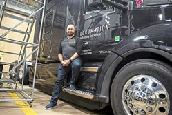 Çetin Meriçli, CEO of Locomation in front of one of Locomation's  Self-Driving Test Vehicle at the Locomation garage Wednesday, Mar. 11, 2020 in Pittsburgh.