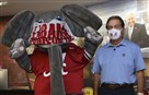 In this May 20, 2020 photo provided by the University of Alabama, football head coach Nick Saban and the school's elephant mascot, Big Al, wear masks on the university campus in Tuscaloosa, Ala.