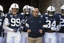 Penn State coach James Franklin leads his team onto the field for a game against Indiana.