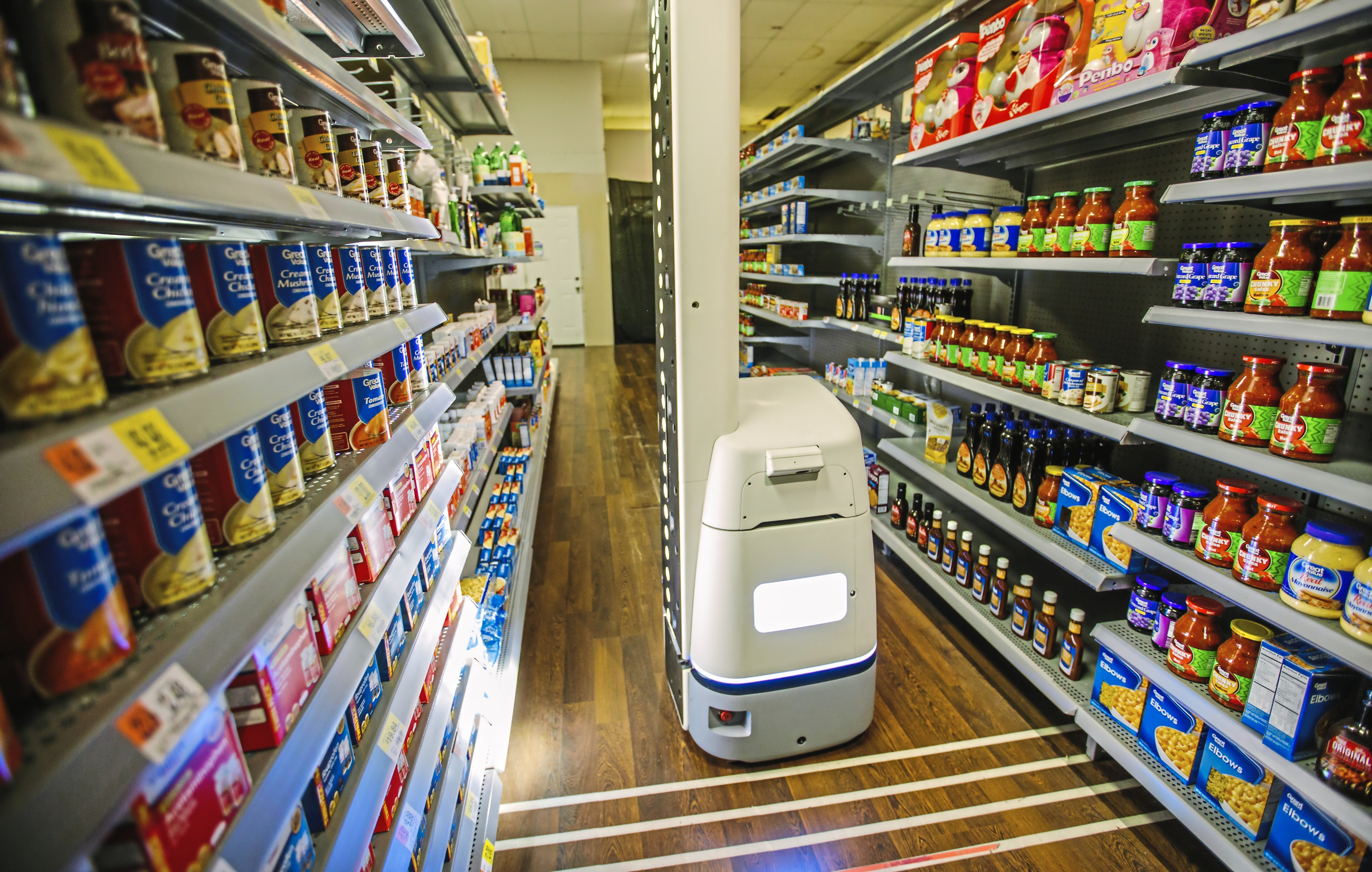 A robot made by Bossa Nova Robotics checks inventory in a mockup Walmart  aisle at the company s test lab in the Strip District. (Andrew  Rush Post-Gazette) e5237e6d9