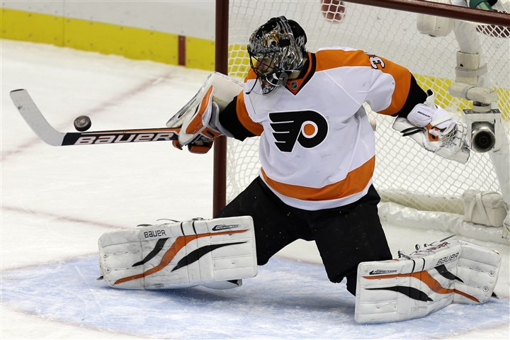 NHL Free Agency Hockey In this Feb. 20, 2013 file photo, former Philadelphia Flyers goalie Ilya Bryzgalov blocks a shot in the first period of a game against the Penguins in Pittsburgh.