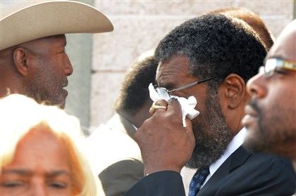 Daily1008b.jpg Former Steelers defensive tackle Joe Greene uses a tissue to wipe his eyes after the funeral services for his teammate L.C. Greenwood.
