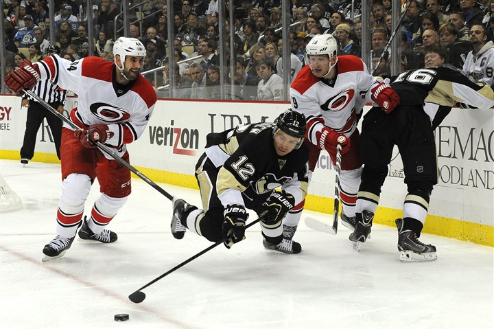 Daily1009n Penguins right winger Chuck Kobasew scrambles for the puck against the Hurricanes earlier this month.