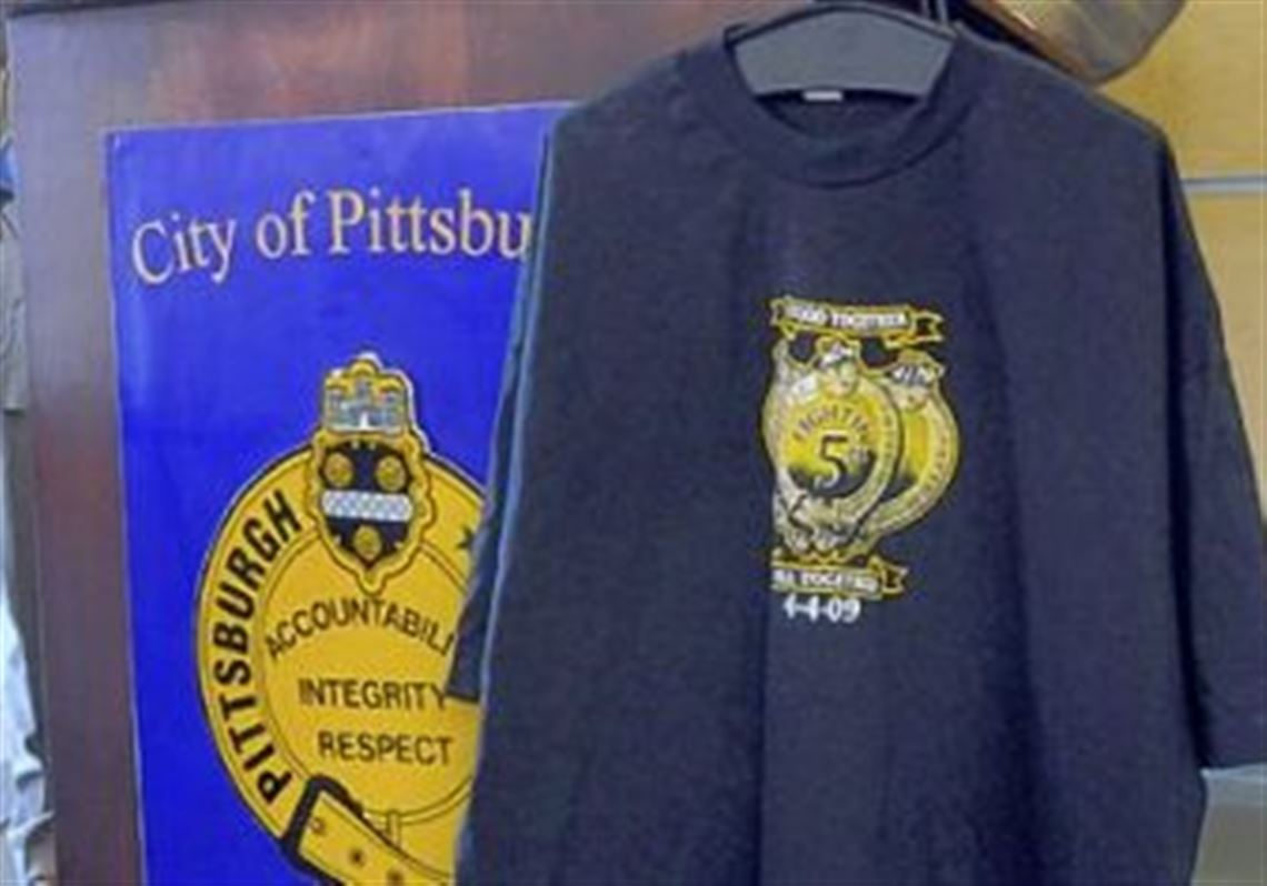 Commemorative T-shirt helps fallen officers  families  243721631