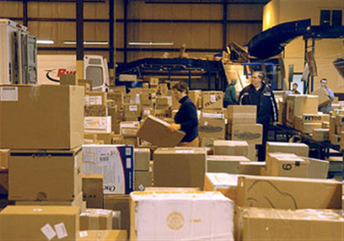 20a1b38fd6 Packages are arranged and carried to waiting trucks at the FedEx location  in Aleppo. 1. MORE. FedEx gears up for holiday shopping season