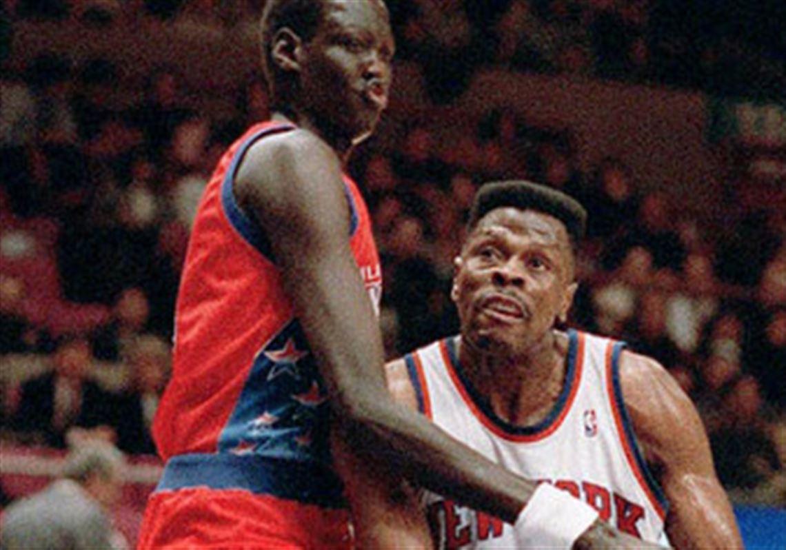 052c937a8c65 The New York Knicks  Patrick Ewing is blocked by Philadelphia 76ers  Manute  Bol