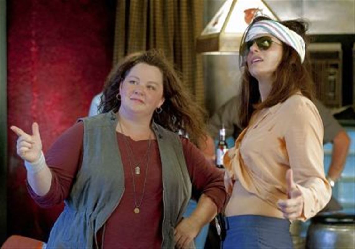 Melissa Mccarthy Left Portrays A Free Wheeling Boston Detective And Sandra Bullock Is