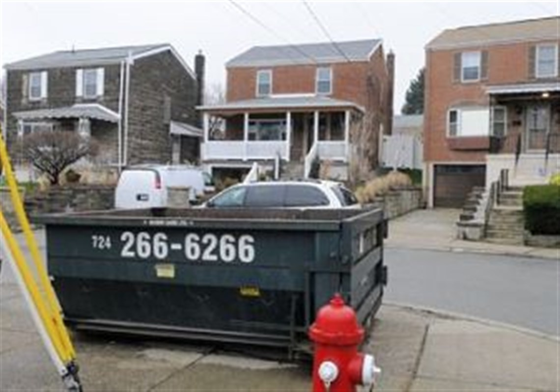 A Dumpster And An Interior Design Company Vehicle In Front Of 4337 Glen Lytle Road