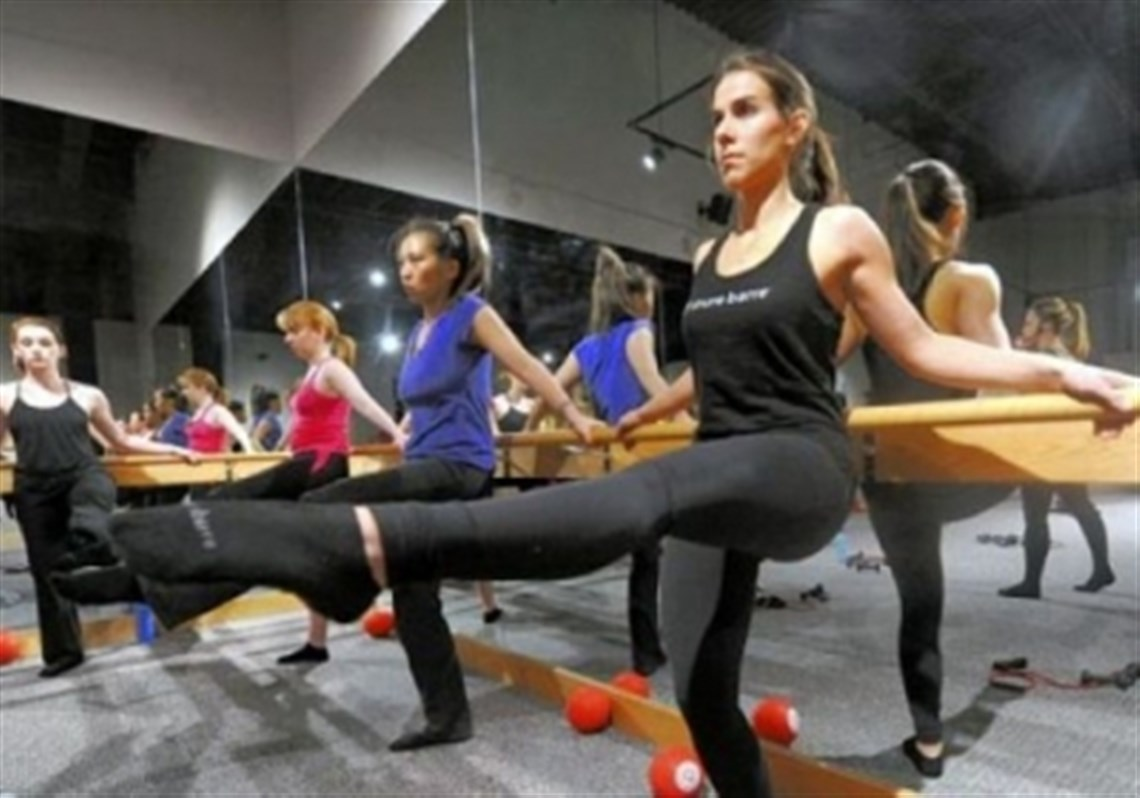 Pure barre is a new way to work out in pittsburgh pittsburgh anna lind exercising at the bar 3 pure barre xflitez Gallery