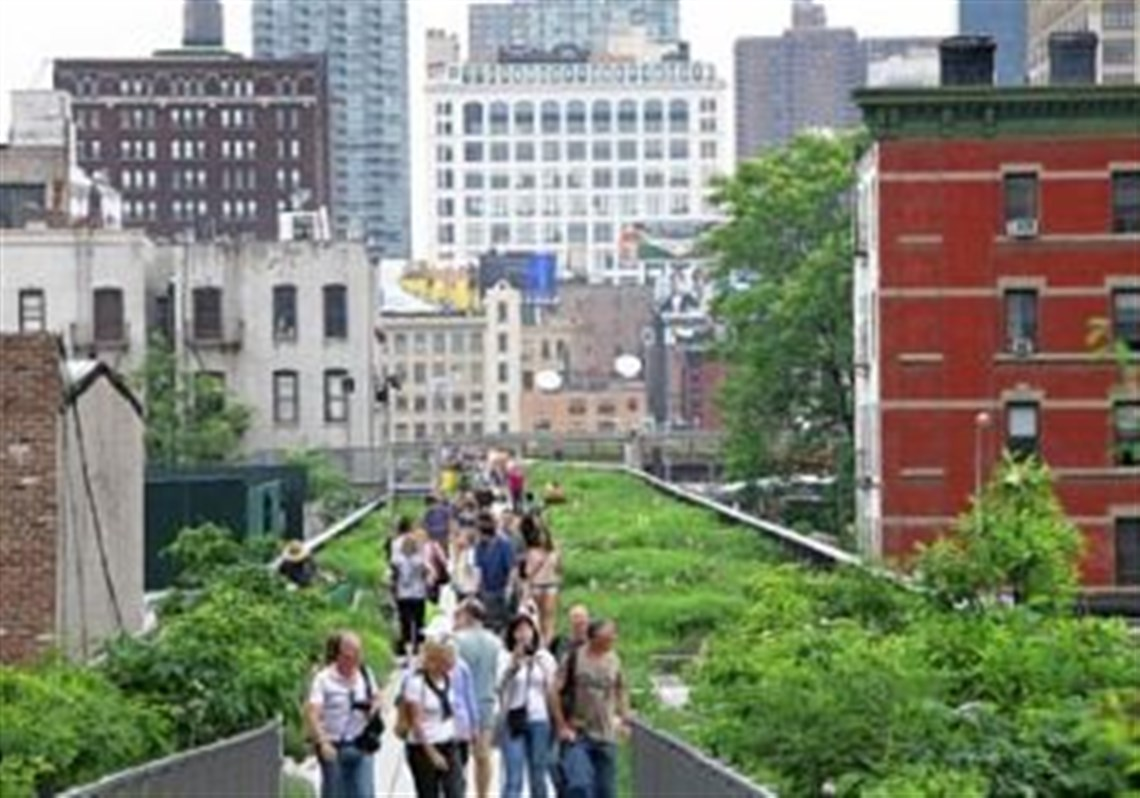 Visitors Walk On New Yorku0027s High Line, A Public Park That Has Been  Constructed On