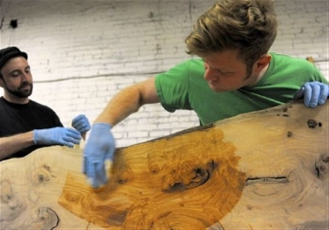 Apprentice Brian McLeod, Left, Works With Jason Boone To Apply Tung Oil To A