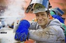 "Mike Rowe next to venting gas on torch bottles at Cash's Scrap Metal in St. Louis during one of the episodes of ""Dirty Jobs"" on the Discovery Channel."