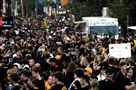 Thousands of Pirates fans make their way to PNC Park for the National League wild-card game against the Reds last season.