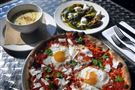 Pizza with sunny-side-up eggs