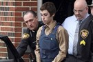 T.J. Lane, the suspect in the shooting of five students at the high school in Chardon, Ohio, wears a bulletproof vest as he is escorted Tuesday from juvenile court.