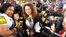 From the archives: Theodora Polamalu holds the Lombardi Trophy as her husband Troy holds their son Paisios during the Super Bowl XLIII celebration Feb. 1, 2009 in Tampa, Fla.