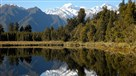 The snow-capped Aoraki, also known as Mount Cook, is reflected in the still waters of Lake Matheson, New Zealand.