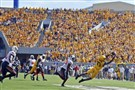 West Virginia wide reciever Jordan Thompson hauls in a pass during a game against Oklahoma State in September 2013.