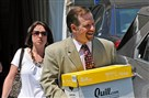 Defense attorney Karl Rominger carries case files out of the Centre County Courthouse during the Jerry Sandusky trial.
