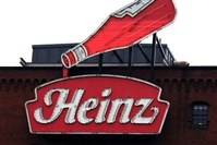 An animated neon Heinz ketchup bottle sign hangs atop the Senator John Heinz History Center in the Strip District.