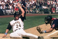 Brian Giles slides past Indians catcher Einar Diaz to score a game-winning run for the Pirates in June 2001.