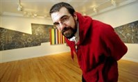 "Biennial curator Adam Welch, shown here in 2008 with his work ""Self portrait as an equation (fractioned/askew),"" when he was named Emerging Artist of the Year at the Pittsburgh Center for the Arts."