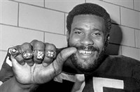 "Steeler ""Mean Joe Greene"" sports his four Super Bowl rings on his fingers at Steelers training camp in Latrobe in 1980."