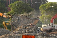 Dust spews during demolition of the Civic Arena.