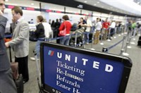 United Airlines passengers check in at San Francisco International Airport.