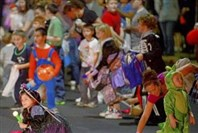 Children rush for candy during Bloomfield's 44th annual Halloween parade on Liberty Avenue in 2012.