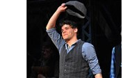 "Actor Jeremy Jordan takes a curtain call during his run in Broadway's ""Newsies."""