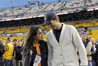 Mila Kunis and Ashton Kutcher walk along the Heinz Field sideline before a Steelers-Bears game. Mr. Kutcher, whose net worth is $200 million has invested some of that fortune in Casper, a bed-in-a-box company.