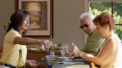 Linda Macaluso serves a sampling of white wines for Ernest Paoletti and his wife, Phyllis, in the tasting room at the Greendance Winery.