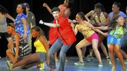 "Angelo Ragghianti, center, of Pittsburgh CAPA, performs ""In the Heights"" during the Gene Kelly Awards presentation Saturday for high school musical theater. Angelo was named best actor."