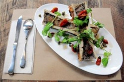 Bone marrow with pea shoots, capers, white truffle vinaigrette and roasted grape tomatoes