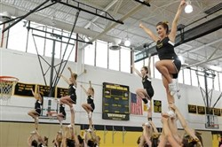 Cheerleaders practice their routines inside the gym at at North Allegheny Intermediate High School .